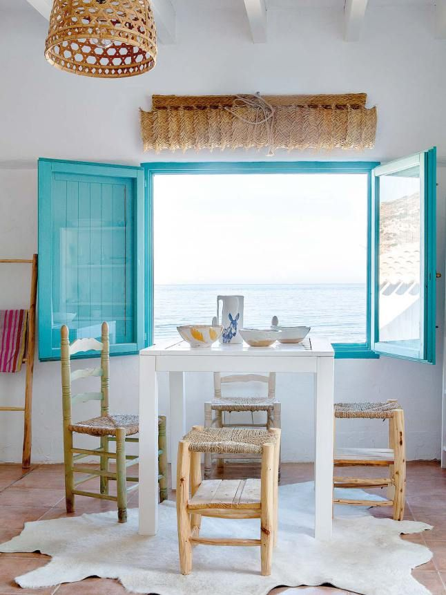 So the hide on the floor may be a big much for my vegetarian tastes, but i love the rattan and the hues in this breezy mediterranean style kitchen