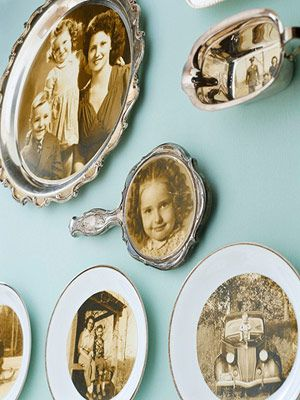 "Photo display with unexpected frames - ""By using a little acid-free glue and adhering their old family portraits to flea-market finds, this collector found a double-duty way to display their loved ones."""