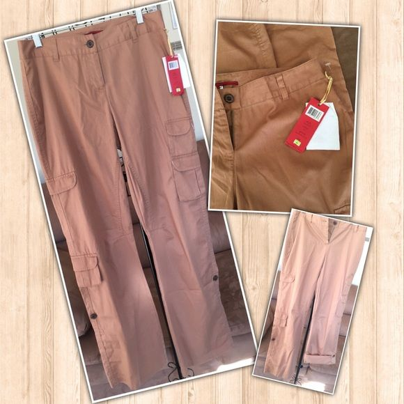 "NWT Ladies's Cargo Pants Adjustable Length 4 These are new with tags. Tapemeasure brand ladies cargo pants size 4. 32"" inseam. Bottom cuffs can be buttoned to a more cropped pant fit with an approx. 24"" inseam. 100% cotton, machine wash. Smoke free home! Tapemeasure Pants Ankle & Cropped"