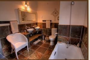 Choose where to Snooze - Karoo View Cottages Bathroom with tub and double vanities