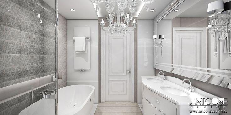 Projektowanie wnętrz pięknej łazienki. Szara sylistyka zapewnia wyciszenie i relaks. Duże lustro optycznie powiększa przestrzeń. Więcej na www.artcoredesign.pl