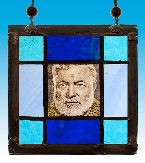 Ernest Hemingway, stained glass suncatcher. For sale at the Etsy shop of Stained Glass Elements