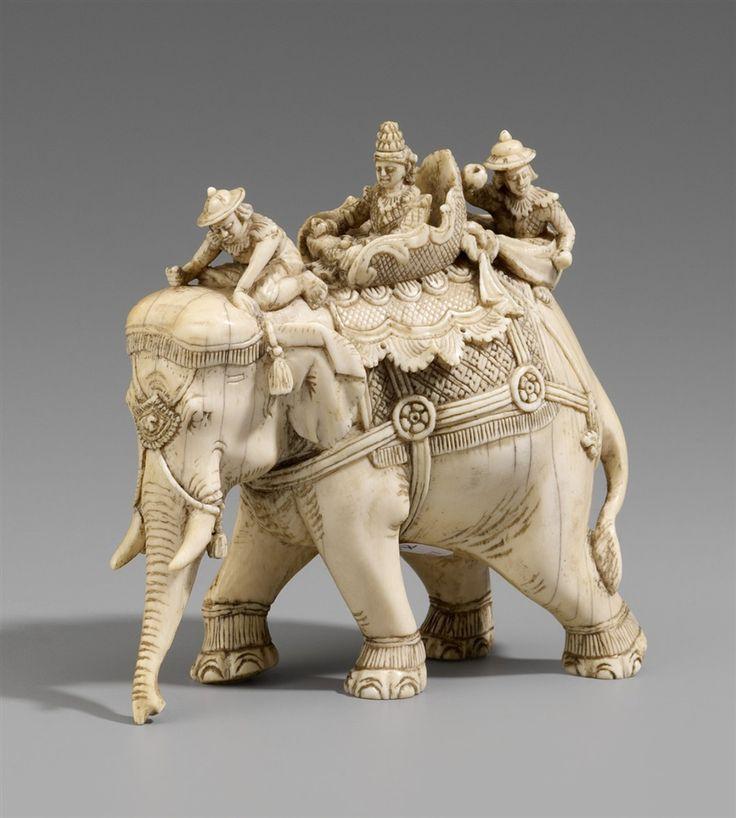 A Thai ivory figure of a caparisoned elephant. Early 20th ...  A Thai ivory fi...