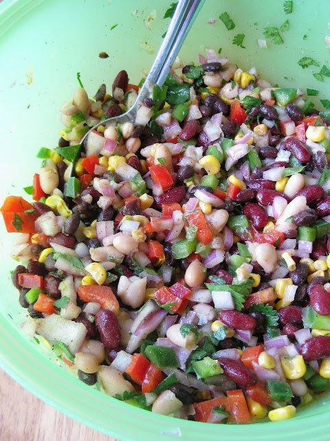 Mexican Bean Salad: Three beans- black, canellini, and kidney- are tossed with piquant peppers and onion, roasted corn, garlic, cilantro, and a zingy vinaigrette @QiaoQiao Jade Jade Jade Jade Jade Jade!