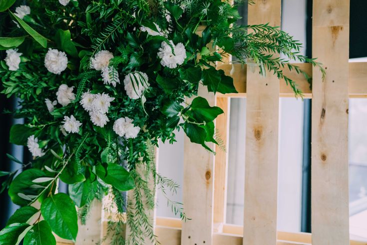 Beautiful green centrepiece on framed backdrop.  Adorn Event Styling @Tailrace Centre