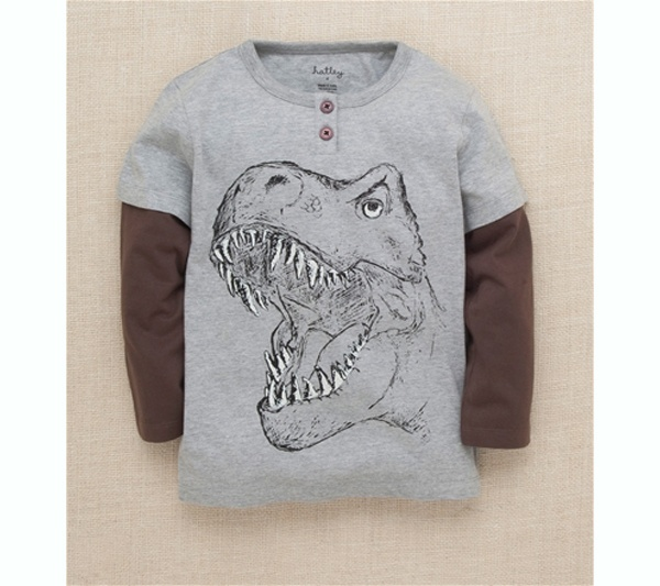 Camiseta gris y marrón con dibujo de tiranosaurio rex,  cuidado !!! muerde todo lo que se le pone por delante !!! Ref. 30120 Precio: 18.00 € IVA incluido
