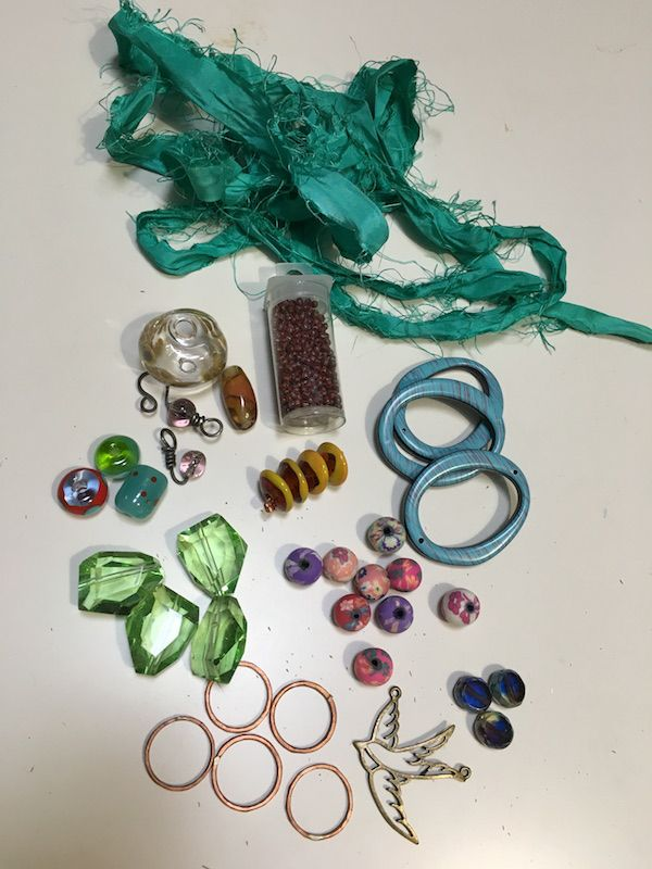 Items from my partner Elisabeth Auld. Included were some polymer clay beads, lampwork beads made by her, seed beads, czech beads, silk ribbon and some copper rings and some acrylic rings with a metal bird spacer bead.
