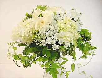 This bridal or bridesmaid bouquet is created by combining and hand-tying garden flowers - roses, hydrangea, queen anne's lace, phlox, and accented with clematis vine.