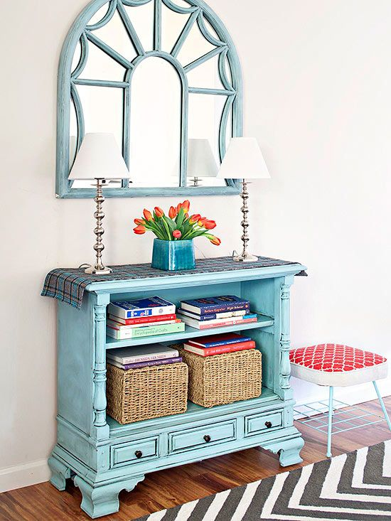 You'd never guess that this clever storage console was a console of a different kind in a past life. Blogger Beckie Farrant (infarrantlycreative.net) removed the workings out of a vintage console TV, painted and glazed the frame, and created a brand-new storage console.
