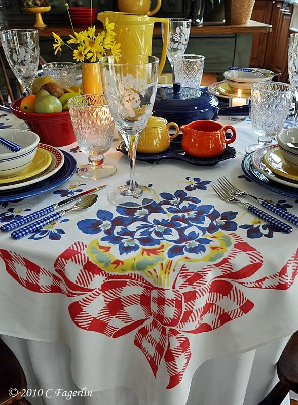 Americana Dining / Happy Tablecloth With Bright Fiesta Ware.