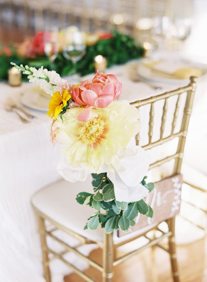 The prettiest peony adorned sweetheart chair: http://www.stylemepretty.com/2015/10/05/colorful-morais-vineyard-wedding-in-virginia/ | Photography: Joey Kennedy Photography - http://www.joeykennedyphotography.com/
