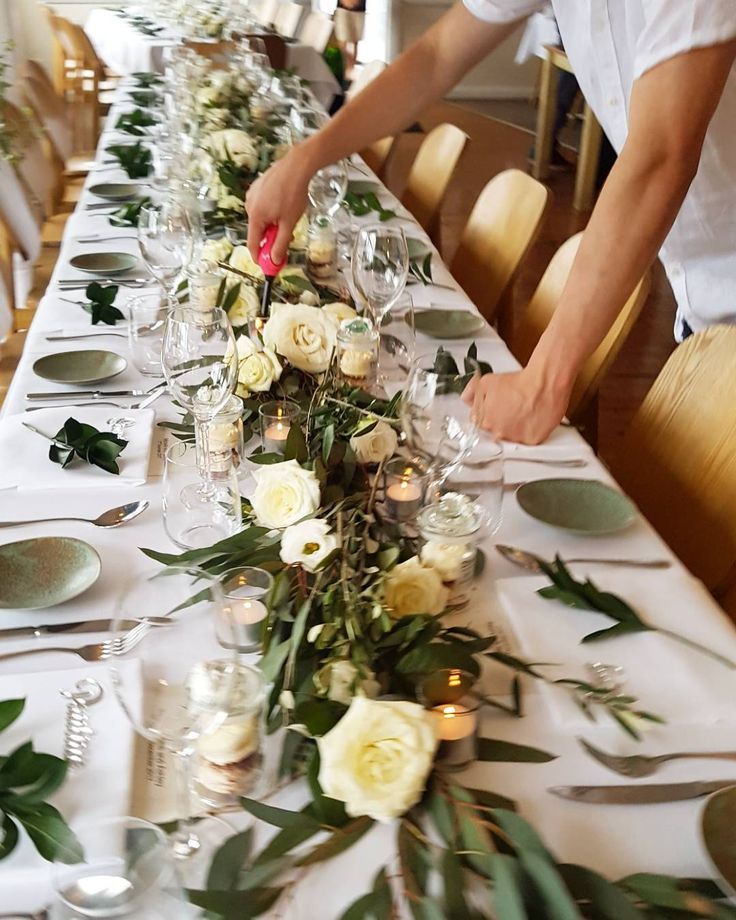 gorgeous white and green wedding table garland centerpiece running down the middle with candles