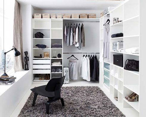 i would love to have a closet this big, bright, organized, and that eames chair is to die for! this space looks so calm and relaxing...