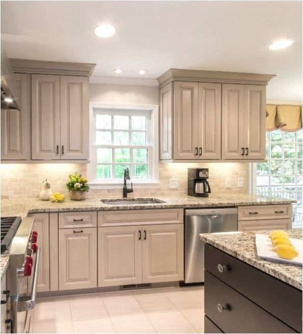 Taupe Kitchen Cabinets Love the dark stain color on the island...use this to tie into dark crown molding.