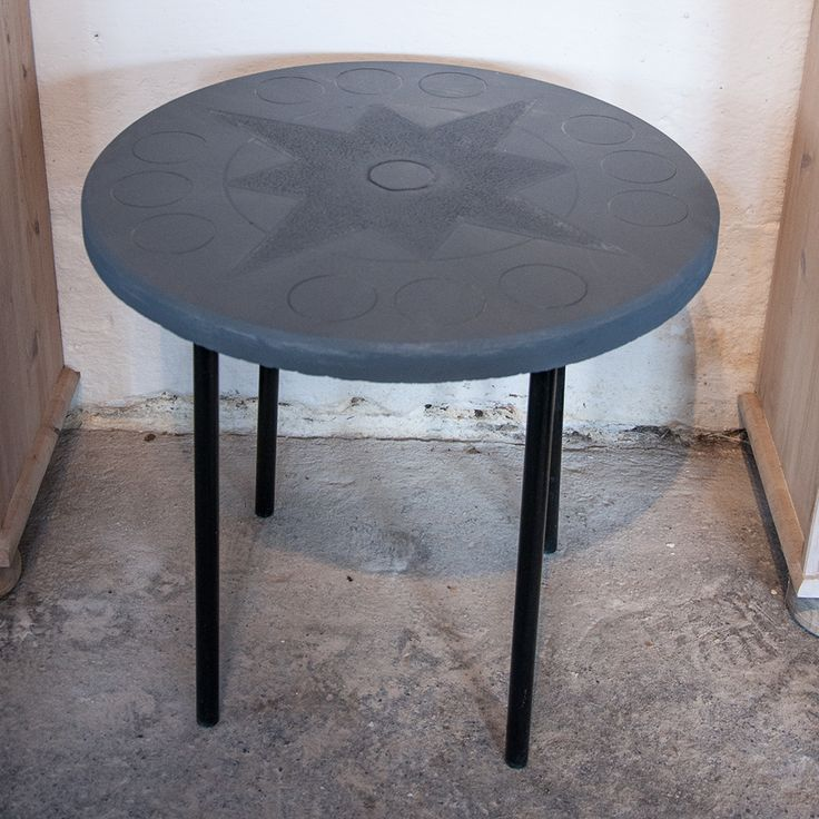 Concrete table with compass