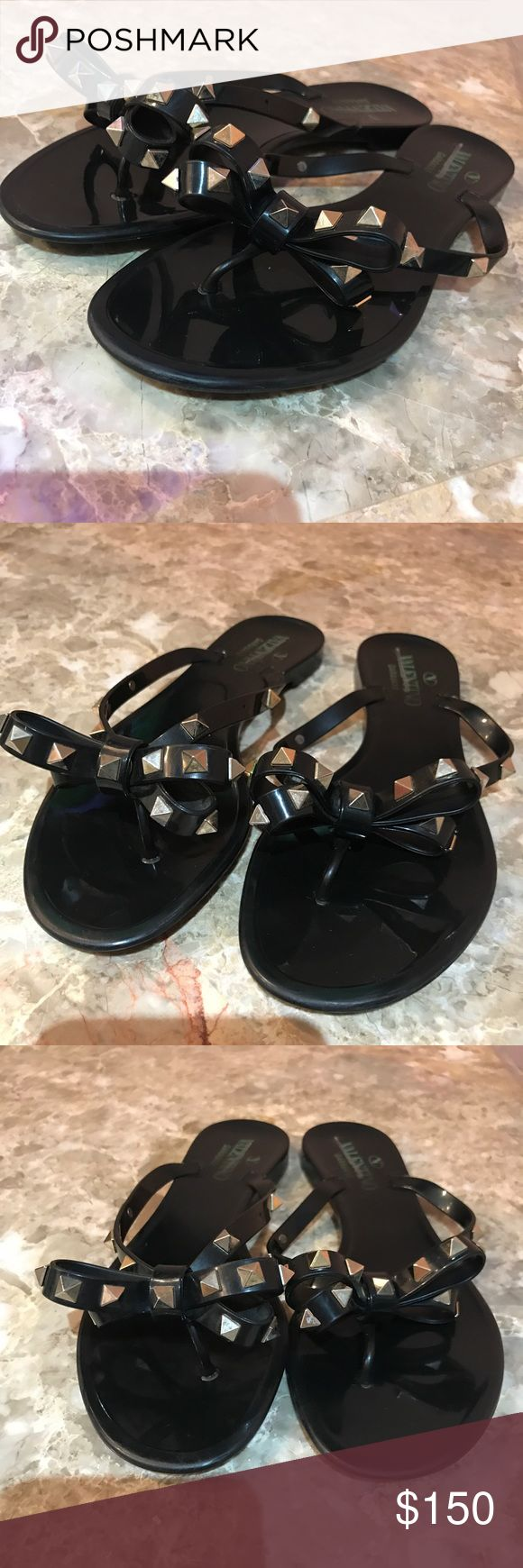 VALENTINO ROCKSTUD BOW PVC JELLY SANDALS SLIDES 37 Valentino Rockstud Bow Jelly Sandals. Size 37. Preowned in good condition. Two studs are missing please review photos they are both on the right foot. One is on the inner thong strap close to the sole (very unnoticeable) the other is hidden in the Bow (also unnoticeable) but judge for yourself. No box or dust bag 100% authentic. For sale only no trades thanks and Happy Poshing 💗 Valentino Shoes Sandals