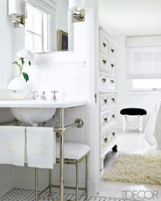 This is beautiful. Old fashioned sink, pretty chest of drawers in the background.    The sink, fixtures, and marble basket-weave floor tiles in the bathroom are by Waterworks.    Photographer: John Granen