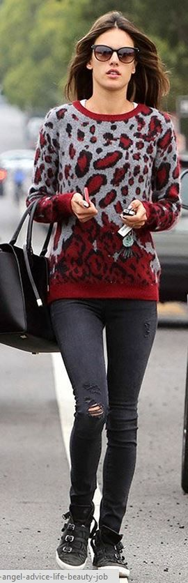Who made  Alessandra Ambrosio's red animal print sweater, black sneakers, and leather handbag?