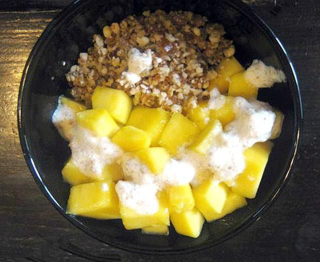 A homemade raw foods diet breakfast cereal similar to a healthy muesli or granola cereal with fresh fruit and topped with raw nut milk. This…
