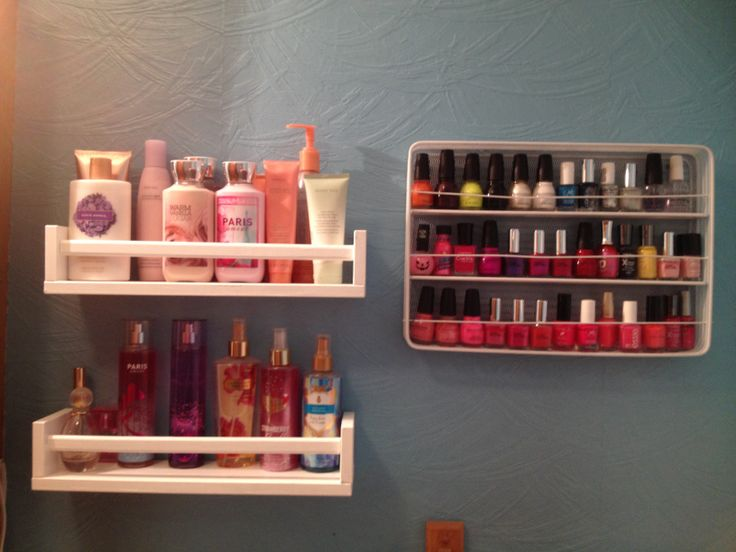DIY nail polish rack (wire large utensil tray from bed bath and beyond,and wire hangers) painted white....2 ikea shelves painted white for lotions and body sprays