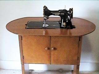 Singer 221 sewing machine, fondly known as a Featherweight. This is the only cabinet Singer ever made for the 221, and it is very hard to find.