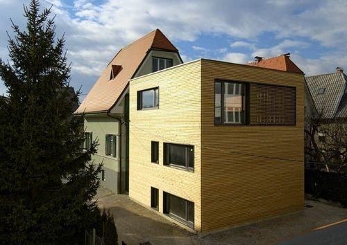 Revestimento de fachada em madeira LARCH FAÇADE ON A HOUSE EXTENSION RIKO HAUS   – Contemporary house extensions