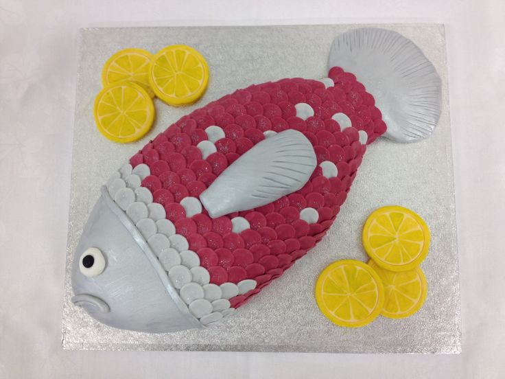 Fish cake complete with slices of lemon