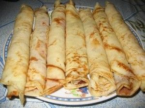 Hungarian Pancakes (Palacsinta). Like mine with grape jelly or cinnamon and sugar inside.