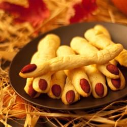 "Sppoky Witches' Fingers | ""I made these cookies for my son's school party and they were a great hit. We added green food coloring to the dough."""