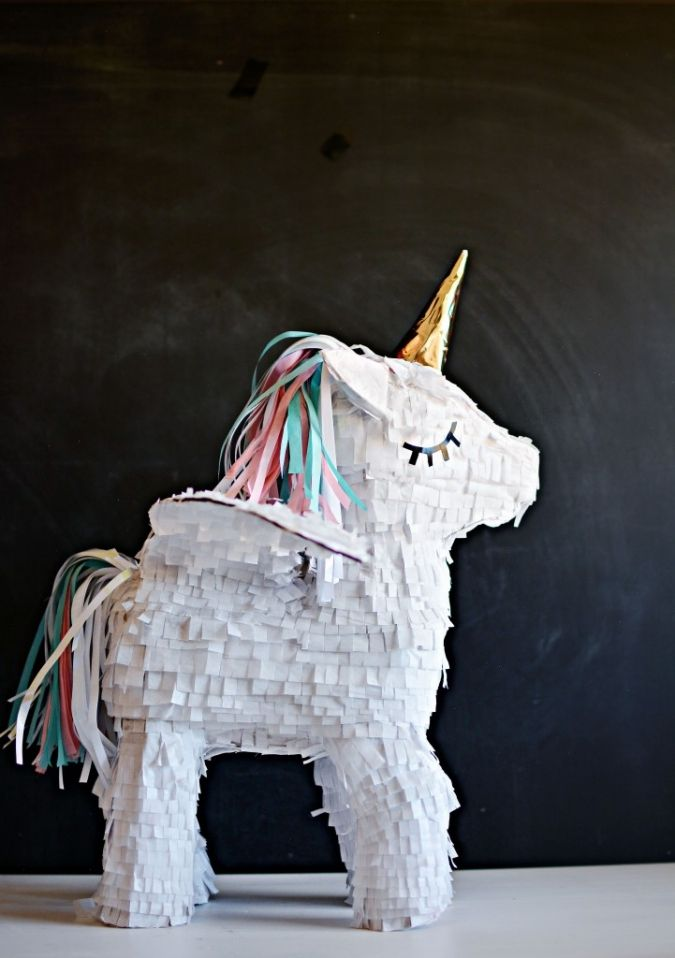 A pull-it-down version of these unicorn piñata would be perfect to keep this sweetie in a good shape to use it later on as part of your little one's room decoration.