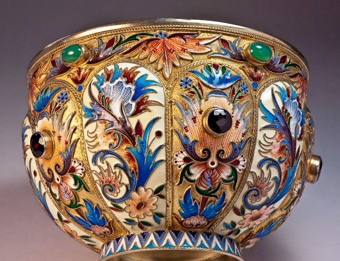 In the late 19th -early 20th century  there was a revival of interest in old Russian shapes and decorative motifs. Moscow silversmiths followed the trend and produced various silver objects in the 17th century taste with or without enamel, sometimes decorated with cabochon semi-precious stones. In the 17th century, enamel was used to enrich silver bratinas, kovshes (boat shaped bowls with one handle), stopas (beakers), icons, etc.