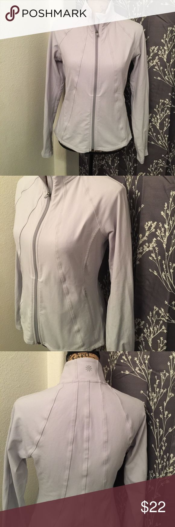 Athleta gray silver zip up jacket Very nice quality!! Worn and washed gently. Not a whole lot of wear just to and from spin classes. No stains or tears. Great condition! Athleta Jackets & Coats