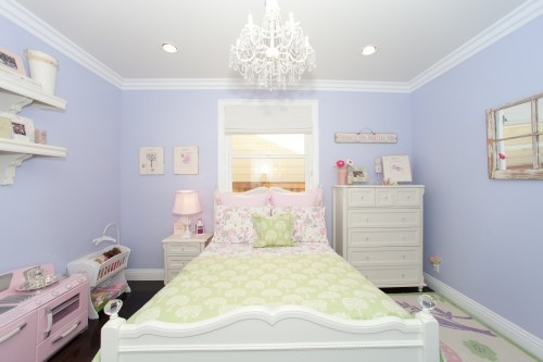 The walls in Grace's room are about this shade of blue.  She wants a girly room, and I don't want to repaint.  Something like this could work.