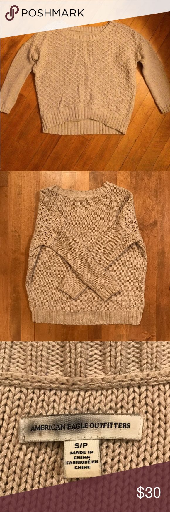 American Eagle Tan Sweater AE sweater, nice and cozy! Size small. Wide boat neck, could be worn off the shoulder. 3/4 sleeves, high low fit. Looks cute with denim shorts or paired with skinny jeans and boots in the Fall! Great condition. Reasonable offers welcome! No trades. American Eagle Outfitters Sweaters