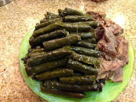 This is a traditional stuffed grape leaves, or dolma, recipe. A mixture of meat and rice is rolled in tender grape leaves and cooked in a citrus broth.