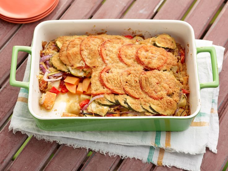 Tomato Vegetable Casserole : Giada's colorful veggie casserole, full of potatoes, yams, bell pepper and zucchini, would be excellent alongside grilled steak. Thanks to the crusty Parmesan-breadcrumb topping, it's filling enough to serve as a vegetarian main course, too. via Food Network