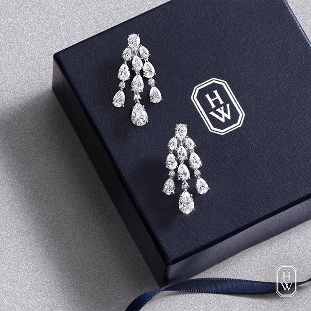 Harry Winston Classic Chandelier Earrings feature 9.27 carats of extraordinary round brilliant and pear-shaped diamonds.