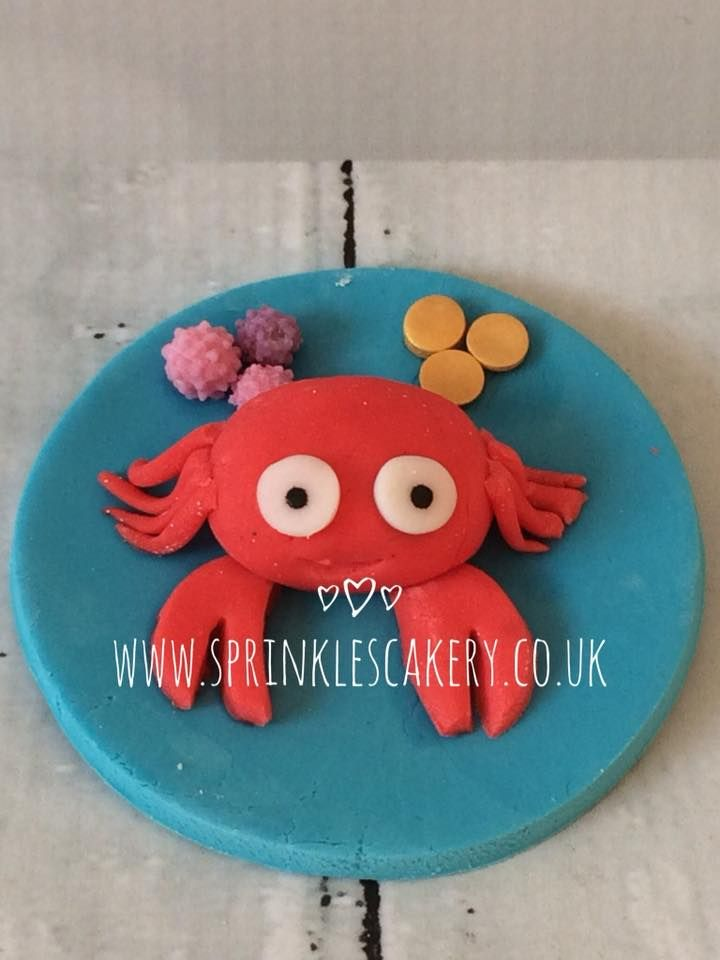 This cute sealife crab cupcake topper was crafted from fondant and then finished with some shop bought sprinkles.