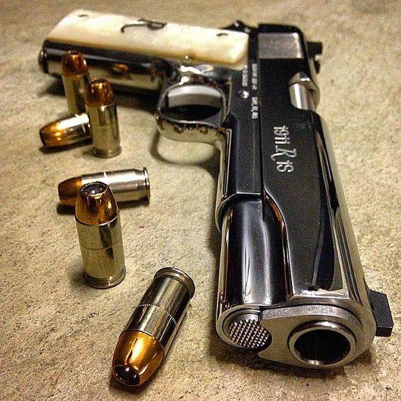Remington R1 1911 .45acp High Polished pistol.