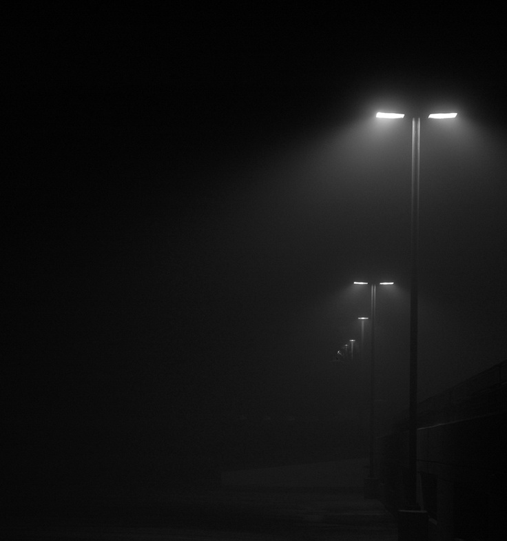 Neath the halo of a streetlamp...I turned my collar to the cold and damp...