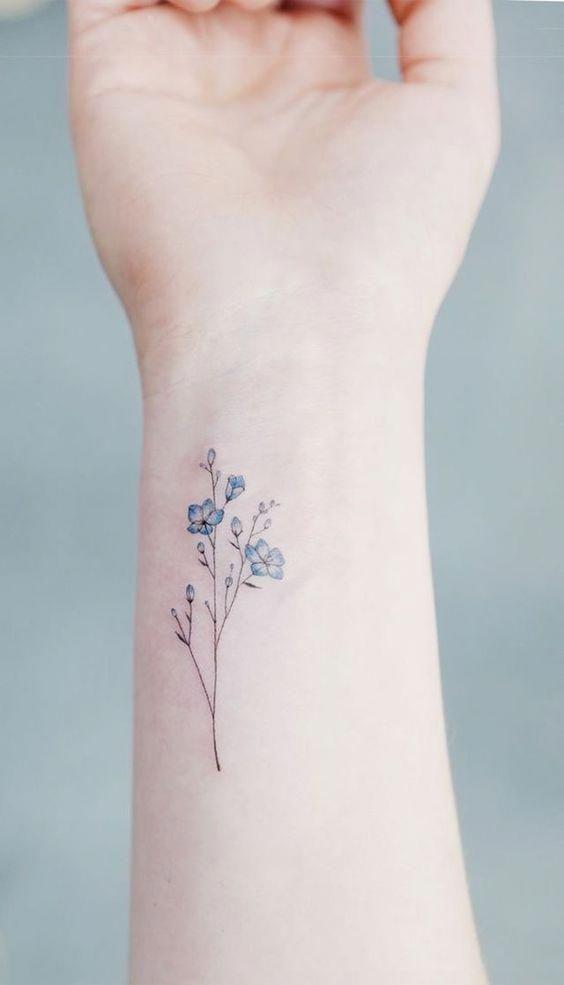 Elegant forget me not tattoo on the inner wrist #wristtattoos
