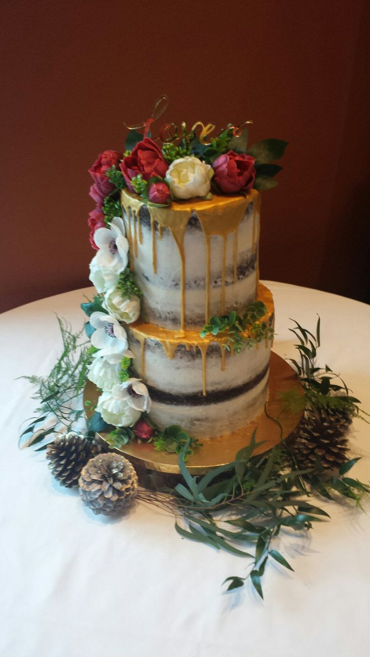 Barely iced chocolate cake with  gold dripping wedding cake.   Chocolate cake with salted caramel swiss meringue buttercream filling.