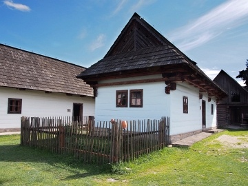 Wooden folk house located in open-air museum of Liptov Village, Slovakia. This open-air museum shows typical folk architecture of Slovak rural communities and their life-style from 14th to early 20th century. This open-air museum of Lipov village is located in Pribylina, Liptov region, Slovakia. Museum is opened for public and it is definitely worth a visit.
