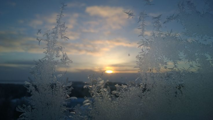 Frozen window and sunset, its look like little fairies made that <3