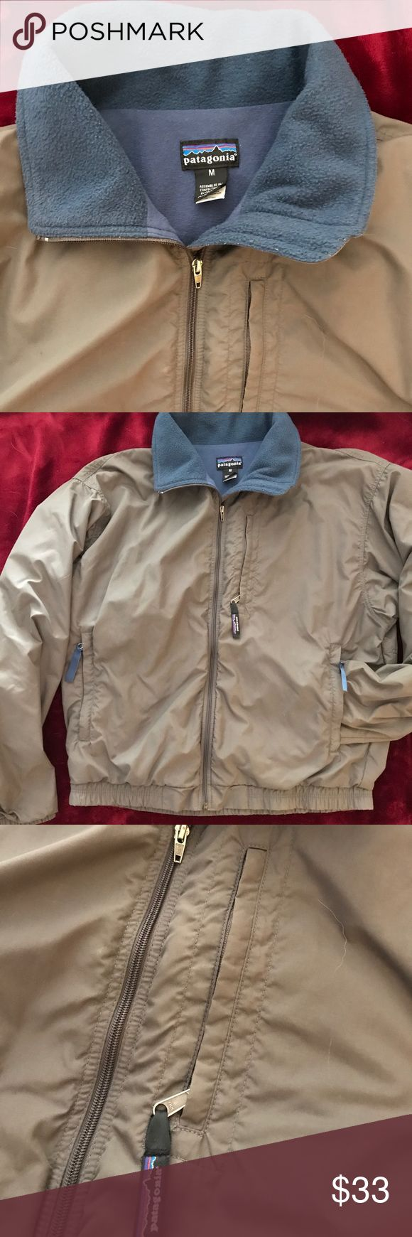 ❤️SALE til Midnite❤️Patagonia Fleece Windbreaker Patagonia W's M Fleece Lined Windbreaker gray and blue, good used condition, minor sleeve seam loosened and elastic in sleeves is not tight from wearing the jacket over sweater layers. Nice weight and neutral colors. Nice zippered hand pockets and chest pocket. Lasting Patagonia quality! Patagonia Jackets & Coats