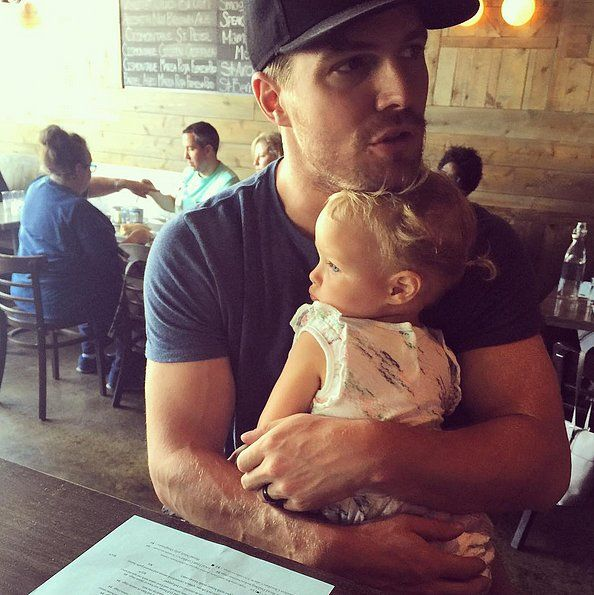 Aww, too cute! Stephen Amell cuddled up to his little girl during a Sunday outing together. Check out more of his sweetest family snaps!