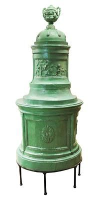 A circular tiled stove with hunting motifs, green glazed tiles. Total height 230 cm, width 100 cm, firing verso by means of rear loading principle, very good condition, Vienna, circa 1780. Wien, Dorotheum, 22.04.15, no. 999.