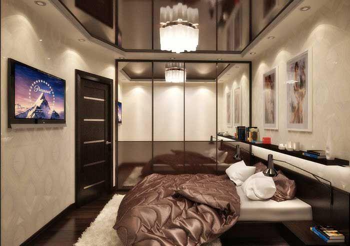 Очередная партия красивых интерьеров спальни от Нины Романюк. Дизайн небольшой спальни с детской кроваткой  Как ясно из заголовка, данный проект спальни подойдет для молодой пары с маленьким ребенком. В узкой спальной комнате разместились большая двуспальная кровать и маленькая кроватка для ребенка.  В комнате для отделки стен использовали комбинированные обои белого и шоколадного цветов. … … Читать далее →