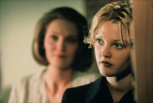 with Joan Allen in a still from Mad Love (1995)