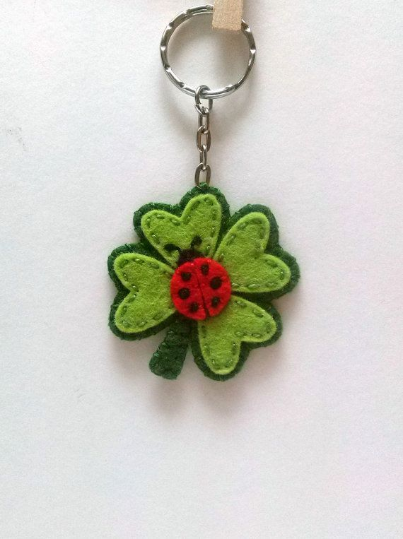 Four leaf clover keychain with small Ladybug - fortune charm This is a perfect good luck gift for anyone. This listing is for 1 keychain - clover with ladybug Good luck charm. Cute ladybug on clover felt keychain. Handmade be me from 100% wool felt Medium sized keychain - diameter of clover is about 5 cm ( 2 inches) Please note that clover is decorated on one side only. Other side is solid green. Material is 100% wool felt. It is high quality felt, very durable and it will not pill. Beca...